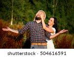 loving couple in field. the... | Shutterstock . vector #504616591