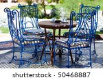 Table And Blue Chairs In The...