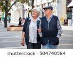 mature couple walking on street ... | Shutterstock . vector #504740584