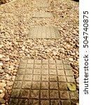 brown tile footpath on gravel | Shutterstock . vector #504740875