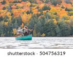 happy couple canoeing in a lake ... | Shutterstock . vector #504756319