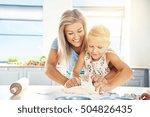 Adoring Young Mother Teaching...