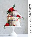 wedding cake with flowers  figs ... | Shutterstock . vector #504960979