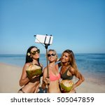 Three Young Women In Bikini On...