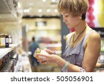 woman checking food exp date in ... | Shutterstock . vector #505056901