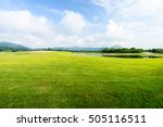 Green Grass Field On Blue Sky...