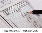 Small photo of Standard test form or answer sheet. Answer sheet focus on pencil. Bubble answer sheet with blank answer. School exam answer sheet and pen.