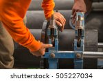 Small photo of Hand of workers holding spanner jaws of death. To screw to lock.