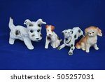 Four Porcelain Dogs On Blue...