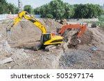 two heavy excavator do ground...