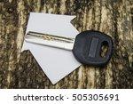 key on wooden background | Shutterstock . vector #505305691