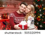 christmas gift. happy couple... | Shutterstock . vector #505320994