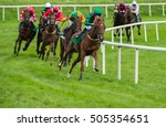 Stock photo horse race taking the turn on the track at speed 505354651