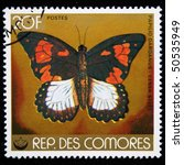 Small photo of COMOROS - CIRCA 1970s: A stamp printed in Comoros shows butterfly Flying Handkerchief, African Swallowtail, or Mocker Swallowtail - Papilio dardanus, general stoll, circa 1970s