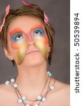 girl with butterfly make-up on face look up - stock photo