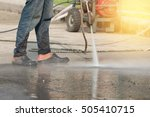 worker cleaning driveway with ... | Shutterstock . vector #505410715