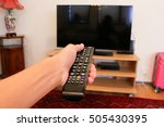 watching tv and using remote... | Shutterstock . vector #505430395