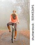 happy active woman riding bike... | Shutterstock . vector #505452691