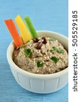 Small photo of Adzuki bean dip with red, yellow and green bell pepper sticks