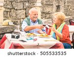 senior couple having fun eating ... | Shutterstock . vector #505533535