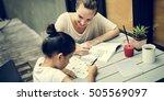 woman and girl doing homework... | Shutterstock . vector #505569097