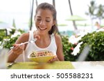 asian woman eating a fresh raw... | Shutterstock . vector #505588231