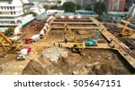 Small photo of tilt shift big project of construction work with day light