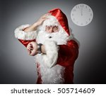 Small photo of Santa Claus is looking at his wristwatch. It's almost twelve o'clock. Concept of being late.