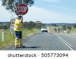road stop sign being held by a... | Shutterstock . vector #505773094
