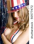 Topless Patriotic Girl with Hat and Suspenders. - stock photo