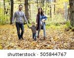 a family of four enjoying... | Shutterstock . vector #505844767