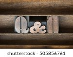 Small photo of Q and A abbreviation made from vintage letterpress type on wooden tray