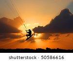 Kite Surfing On Orange Sunset'...