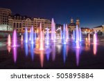 Musical fountain with colorful illumination at night with reflection. Ukraine, Kiev. Travel entertainment sightseeing background - stock photo