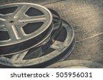 old metal reel of film lie on a ... | Shutterstock . vector #505956031