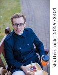 business man sitting on a bench ...   Shutterstock . vector #505973401