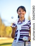 Beautiful female golf player playing with the ball - stock photo