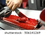 worker uses specialized spatula ... | Shutterstock . vector #506141269