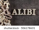Small photo of ALIBI word made with wooden letters