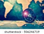 compass on grunge world map...   Shutterstock . vector #506246719