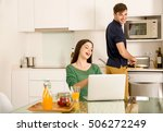 man cooking while her wife... | Shutterstock . vector #506272249