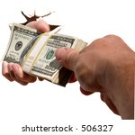 A human hand crashes through an isolated white wall while handing a pile of cash to a different persons hand. - stock photo