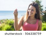 young woman doing rich gesture | Shutterstock . vector #506338759