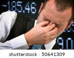 Financial problems. Businessman covering face in disbelief, stock exchange concept - stock photo