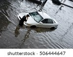 Auto Stuck In Flood Waters.