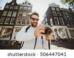 happy stylish photographer with ... | Shutterstock . vector #506447041