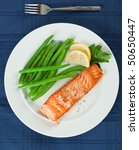 Straight View of Grilled Salmon Fillet with Green Beans Plate - stock photo