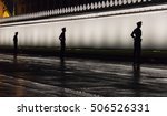 Silhouette Of Police Around Th...