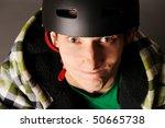 Young male bicyclist in helmet, studio shot. - stock photo