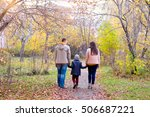 family of three walks in the... | Shutterstock . vector #506687221